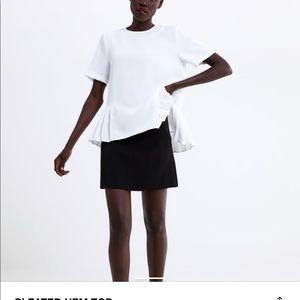 Short sleeve box pleat hem blouse